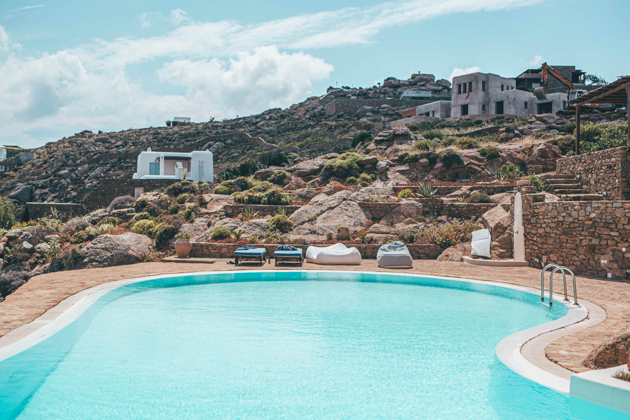 Mykonos luxury mixed with the cosmopolitan feel makes this island hard to miss when hopping around the Aegean Sea
